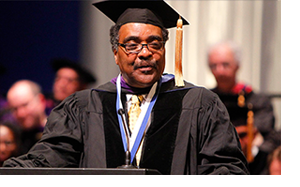 photo of Judge Scott speaking at commencement